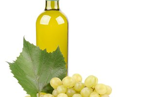 White wine bottle and grapes leaf