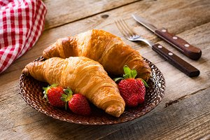 Fresh croissants with strawberries