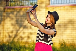 Girl in makes Selfei on street