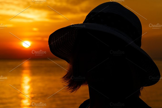 Silhouette of girl. Sea sunset - People
