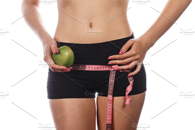 Girl measures buttocks. Hold apple - Food & Drink