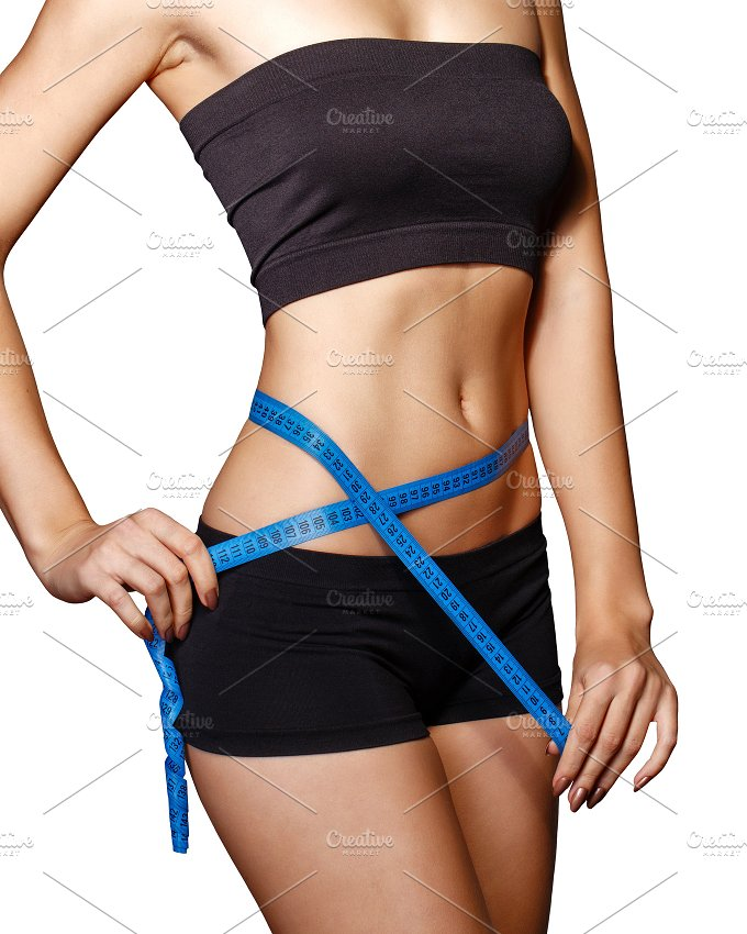 Girl measuring waist. Diet - Sports