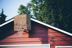 Basketball Net on Red Garage