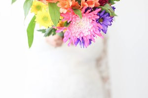 Bride Holding Colorful Flowers