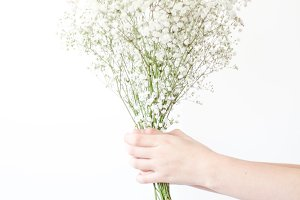 Hands Holding Flowers - White