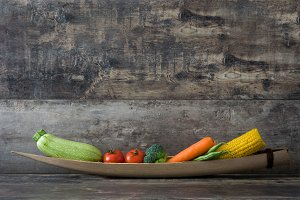 Various vegetables on a rustic wood