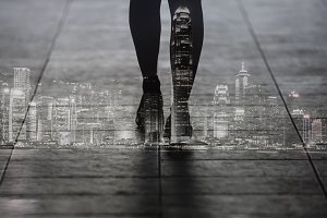 Double exposure woman walk on city