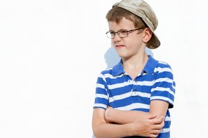 little boy a bully in glasses