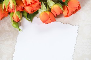 Orange roses and card