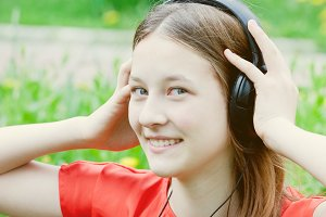 happy teen girl in headphones