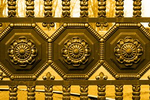 Gold vintage forged metal fence