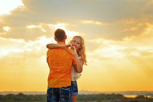 Loving couple embrace. Sunset