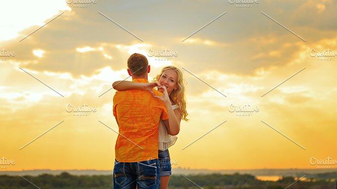 Loving couple embrace. Sunset - People