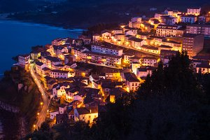 View the city of Lastres at night II