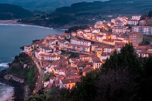 View the city of Lastres at sunset