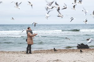 Girl feeding seagulls