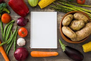 Vegetables and notebook