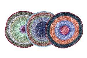 Three handmade knitted rugs