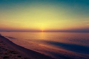 Sunrise at tropical sea and beach