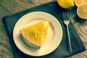 Slice of lemon tart on the plate