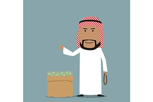 Arab standing near full money bag