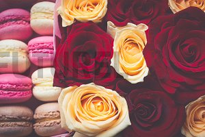 Sweet tasty macaroons and roses