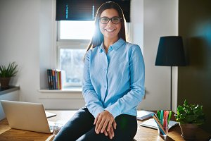 Relaxed confident young businesswoman