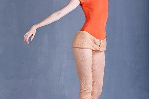 Slim ballerina rehearsing dance.