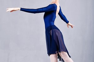 Slim ballerina in blue dress