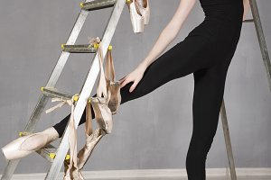 Slim ballerina in black tights
