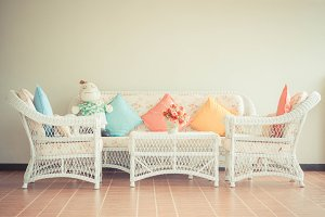 Vintage chair with pillows.