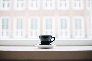 Single Coffee in Window Sill