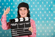 Teenager girl whith a film clapper