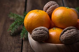 Tangerines, nuts and cinnamon
