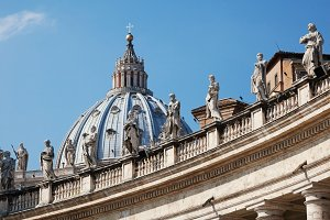 Italy, Lazio, Rome, Vatican City: Dome Of St. Peter Basilica Bernini's Colonnade. Low Angle View.