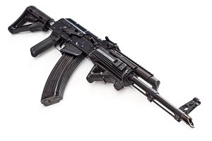 Tactical custom built AK-47 AKM rifle on white background, shallow depth of field