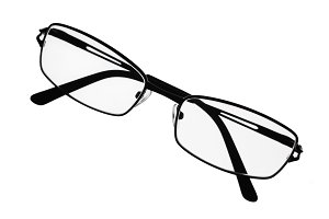 Reading eyeglasses over white surface