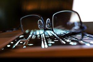 Reading eyeglasses on an elegance laptop keyboard, shallow depth of field