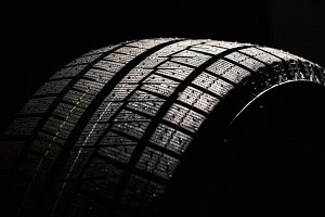 High Performance Winter Tire On Black Background