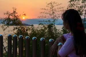 Young woman watching the sunset
