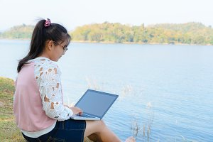 Young girl is using laptop