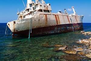 Wreck, abandoned cargo ship aground near the shore of the Sea Caves at Paphos Cyprus