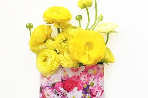 Yellow Ranunculus in Pink Pouch