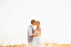 Bride and Groom in a Golden Field
