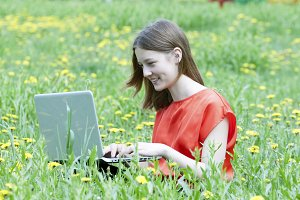teen girl working on a laptop