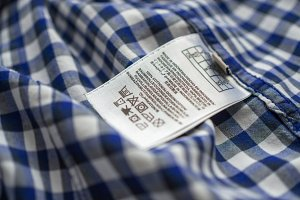 Washing label on the shirt. Shallow depth of field.