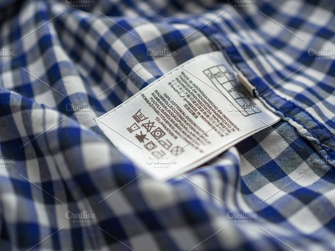 Washing label on the shirt. Shallow depth of field. - Beauty & Fashion