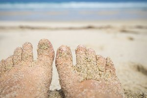 Feet on the sand beach