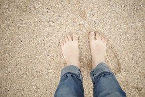 Feet on the sand beach