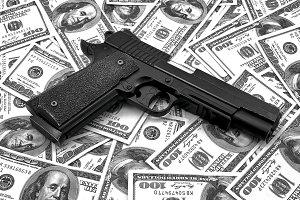 Pistol and money dollars background